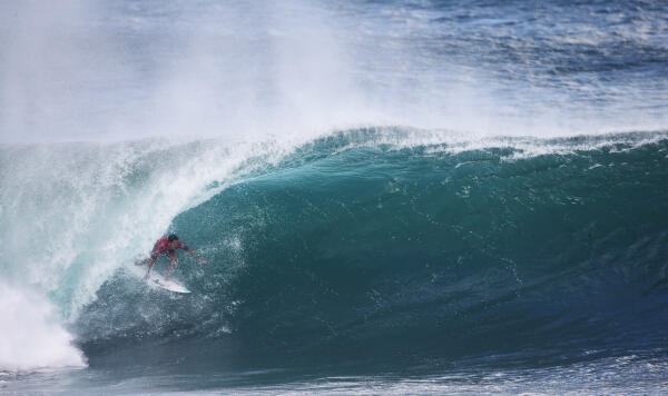 Adriano de Souza finds a wave at Pipe, but couldn't overcome Michel Bourez in Round 1. He will surf in Round 2.