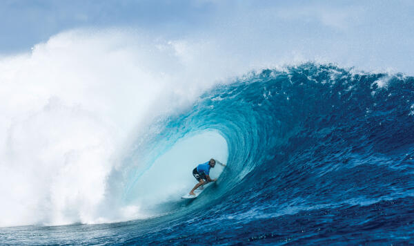 Owen Wright uses two hands to stall in the barrel.
