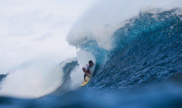 Bruno Santos hugging the face in search for a barrel.