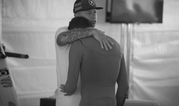 Filipe Toledo and his dad say a prayer before he goes on to win the Final at the Vans US Open.