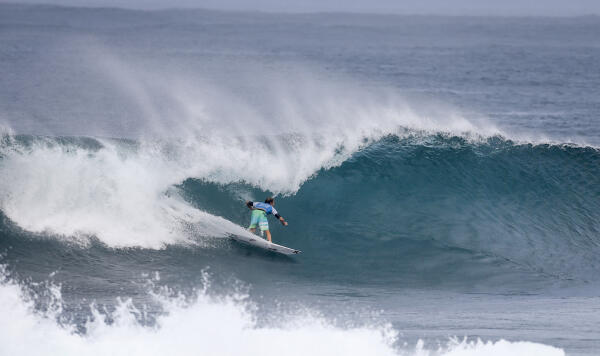 Adrian Buchan finds a barrel at Pipe in Round 2.