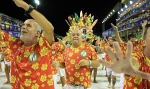 Samba school celebrates Brazilian Carnaval in the streets.