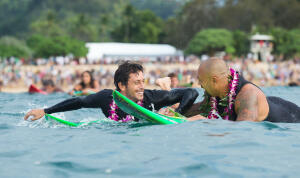 Jeremy Flores & Sunny Garcia paddle out for The Quiksilver In Memory of Eddie Aikau 2014 opening ceremony.