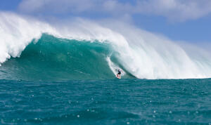 Makua drops into a massive wave