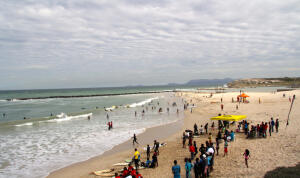 Crowd gathers to watch surfers at Freedom Day surf contest